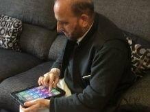 Imtiaz using his tablet
