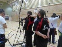 Johnboy shooting a bow and arrow
