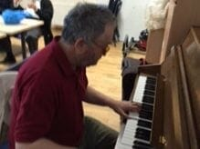 Mark playing the piano