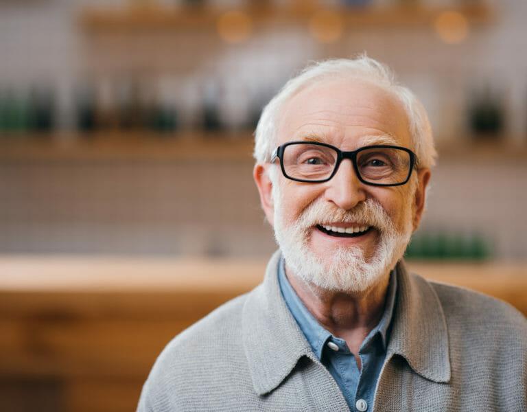 Older man wearing glasses smiling
