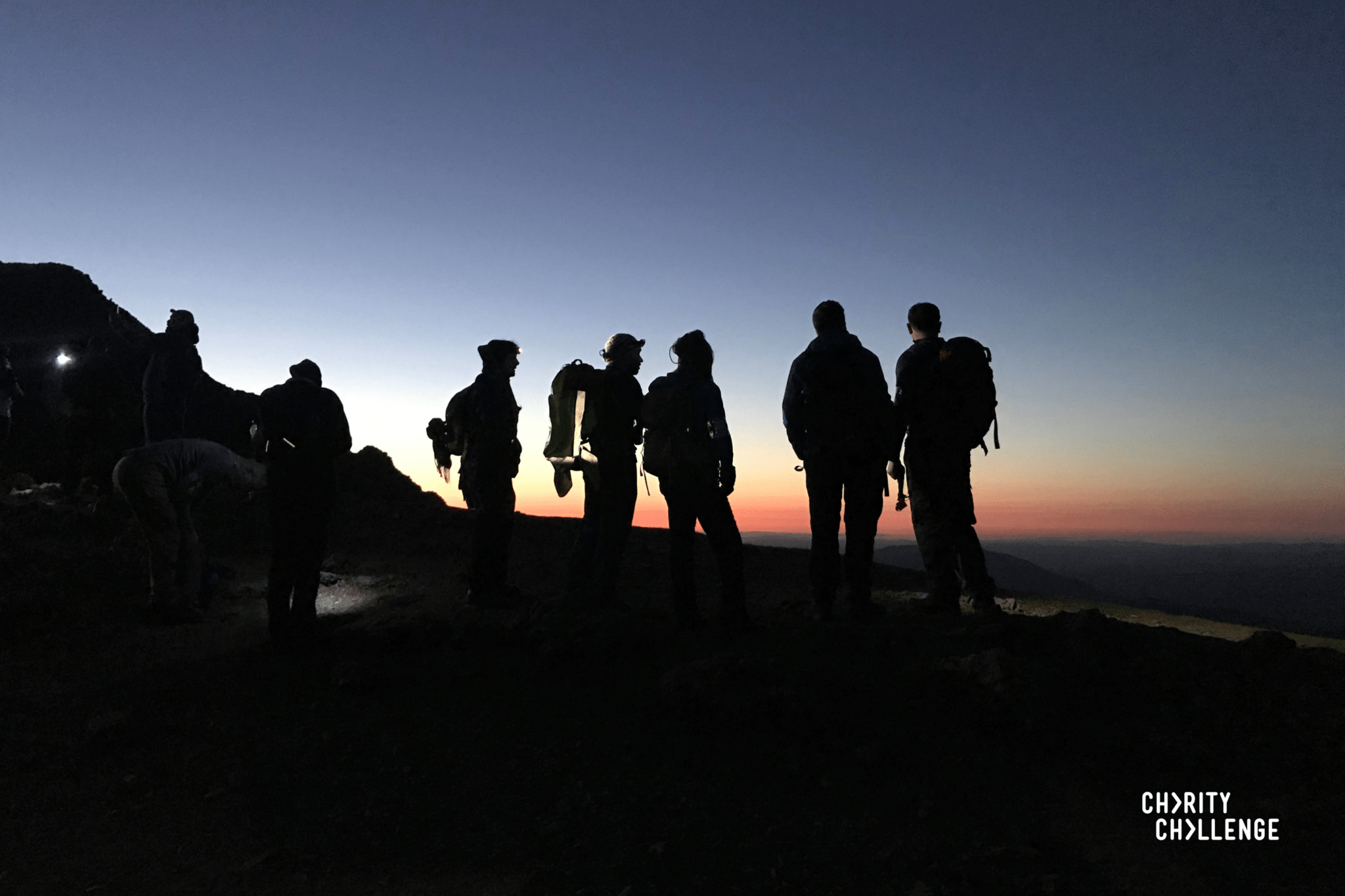 5 people at the top of Snowdon at sunrise