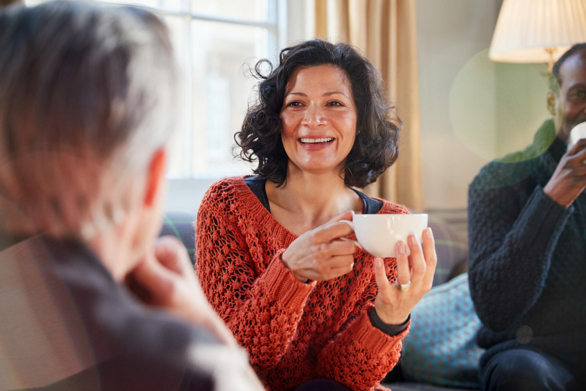 Woman holding a mug smiling