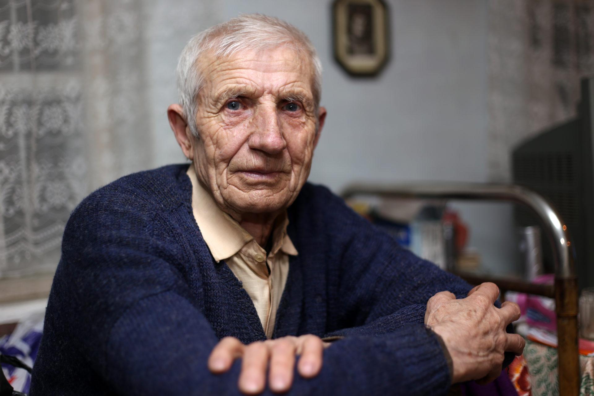 an elderly man sitting alone