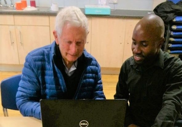 Jim and Sol from Deafblind UK, looking at a computer