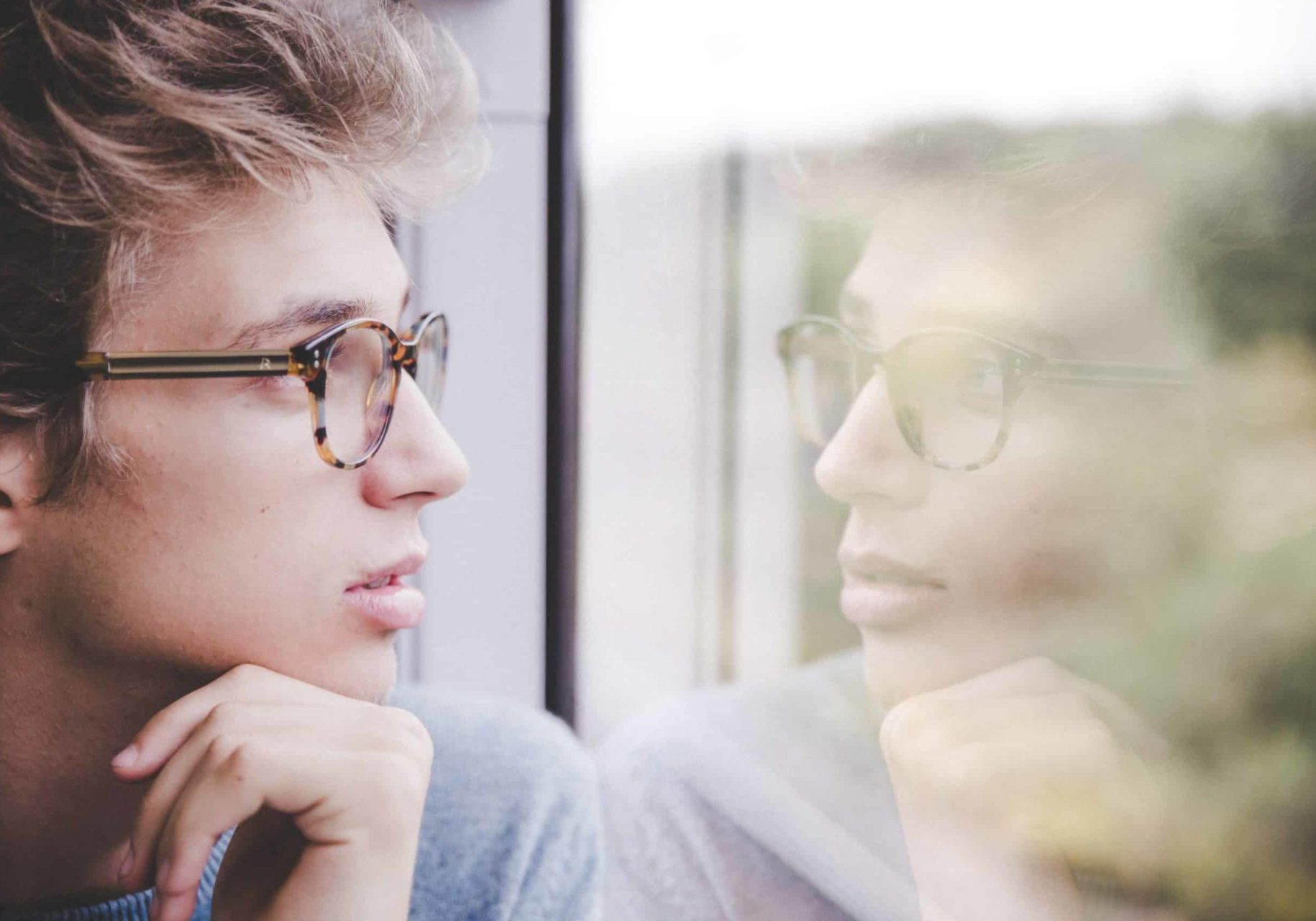 image of a man looking out of a window